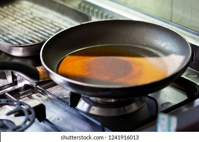 a dirty frying pan in a dirty kitchen