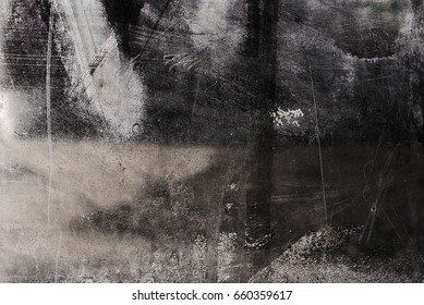 Dirty glass surface is smeared with paint. Interesting, unusual, attractive abstraction