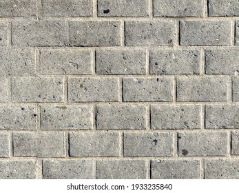dirty gray city urban brick block wall stained and weathered and empty