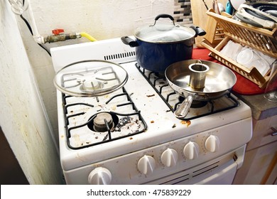 Dirty greasy stovetop in a messy household