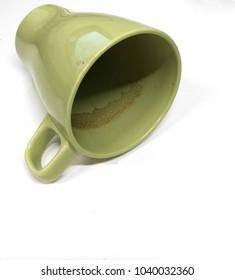 Dirty Green Coffee Mug Tipped Over
