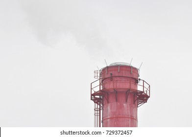 Dirty grey smoke from smokestack in the city. Smoke from district heating