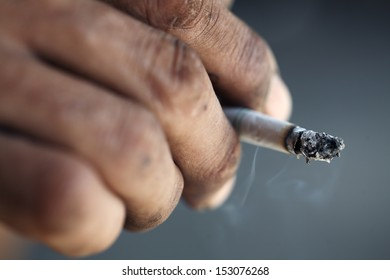 dirty hand with cigarette