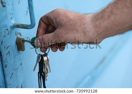 dirty hand man key unlocking padlock stock photo edit now