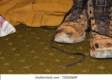 Dirty Hiking Boots on Floor