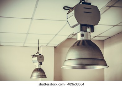 dirty industrial lamp, High Bay Lighting. vintage photo and film style