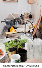 dirty kitchen with messy crockery, leftovers and filthy kitchenware