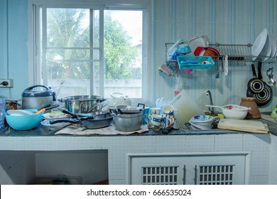 Dirty kitchen, Should be cleaned. Pile of dirty dishes in the kitchen.