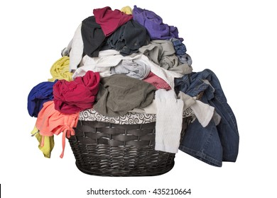 Dirty laundry piled up overflowing in a black basket, isolated on white.
