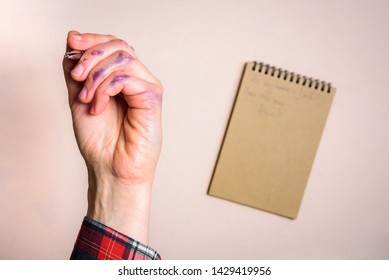Dirty left hand after writing. Left hander day concept. Working place of lefty