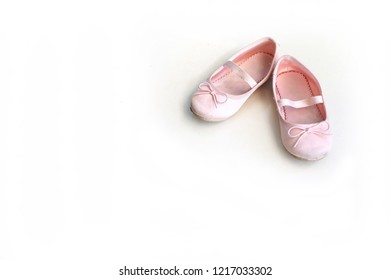 Dirty little girl's shoes with white background.