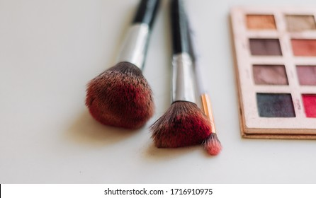 Dirty makeup brushes with a teeny palette