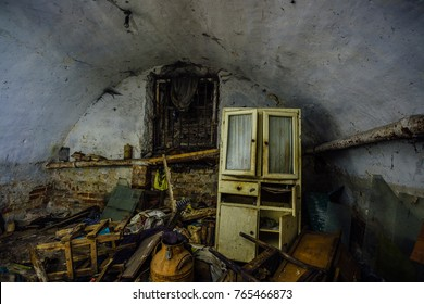 Dirty messy abandoned vaulted underground cellar. Homeless or drug addicts refuge