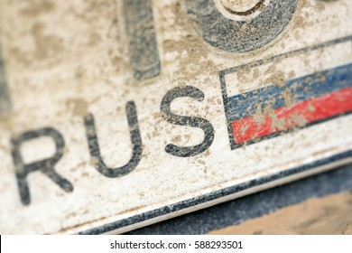 Dirty number plate of car with the image of Russian flag