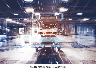 a dirty, oily bus garage inspection pit