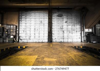 a dirty, oily door of the bus garage