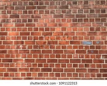 Dirty old big red brick wall