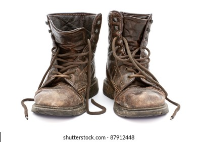 2eeb356468d5 Dirty old boots isolated over white background