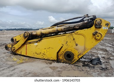 dirty old excavator arm in process of repair.