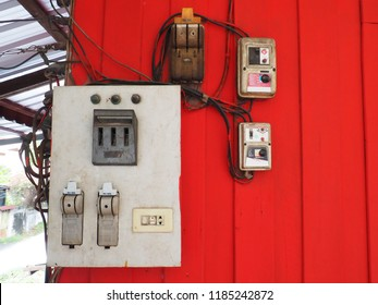 dirty old home power control at red wall  it's including switch, fuse, plug