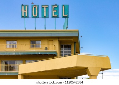 Dirty old hotel sign on the top of a highway motel in an American city