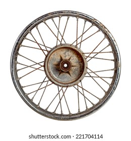 Dirty old spoked motorcycle rim isolated over white