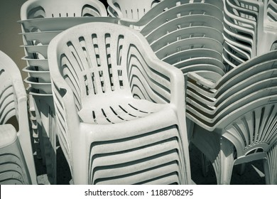 dirty old stacks of plastic chairs