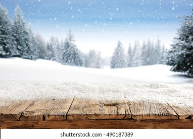 dirty old wooden table place of snow and trees of snow place