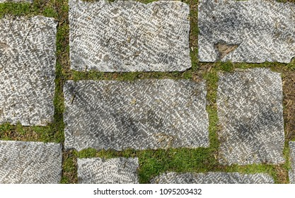 Dirty Outside old granite terrace tiles. Image of exterior flooring with old grey medieval pavement slabs in old European Mediterranean city centre.