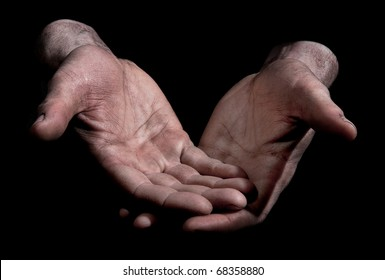 Dirty Outstretched Hands - Fingers closed Dirty outstretched male hands against black background - one hand laid on top of the other