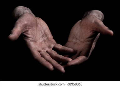 Dirty Outstretched Hands - Open Fingers Dirty outstretched male hands against black background - one hand laid on top of the other - open fingers