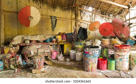 Dirty Paint color buckets for for painting umbella in the shed at Chiangmai, Thailand