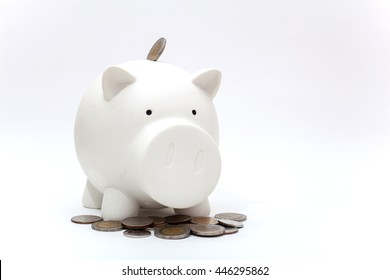 Dirty piggy bank and coin from baby on the white background, piggy bank isolation, saving