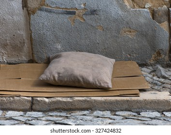 dirty pillow on a paper-box matrass in the street of Lisbon