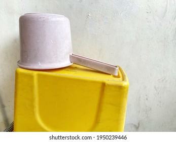 Dirty pink laddle yellow bucket