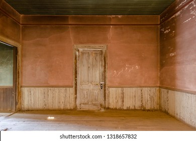 Dirty pink wall and wainscoting in an abandoned farm house deep in the south