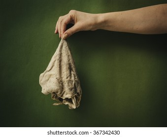 Dirty rags in a female hand.