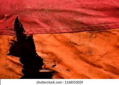 Dirty red orange torn fabric
