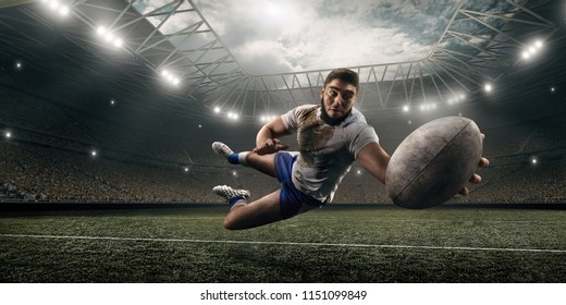 Dirty rugby player catch the ball in flight on professional rugby stadium