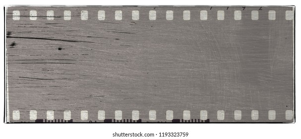 Dirty scratched film strip frame in gray tones.