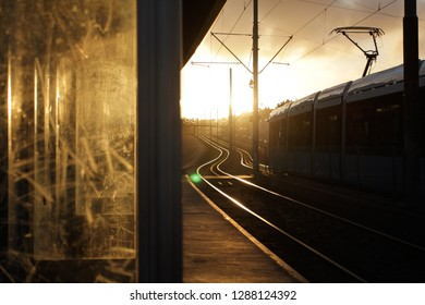 Dirty and scratched glass at a trainstation in backlight