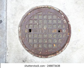 Dirty Sewer Manhole Cover