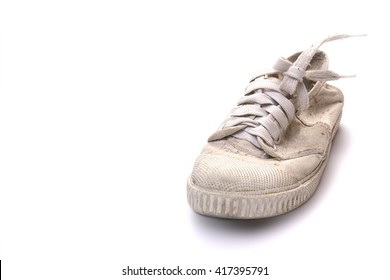 dirty shoe on white background, Old white sneakers, one of old casual sport shoe in white thick fabric