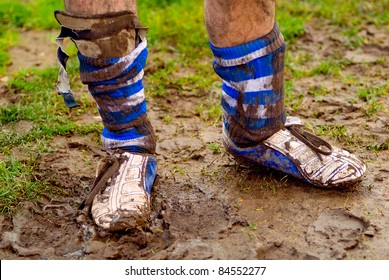 dirty shoes with mud at rugby or football sport