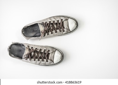 dirty shoes top view on white background