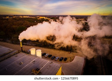 Dirty Smog Pollution cloud rising up and spreading across the landscape and sky Sunrise aerial drone view of Climate Change Smoke Stack asthma cancer casing dangerous smog