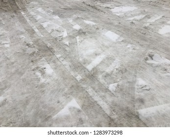 Dirty snow on the road. Cleaning by utilities