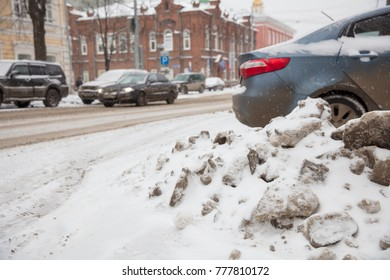 dirty snow and parked car