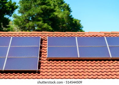 Dirty solar panels on house roof. Dust or on solar panels affects the solar systems output and reduce productivity and savings