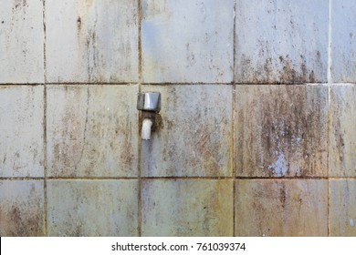 Dirty and stains on the bathroom wall